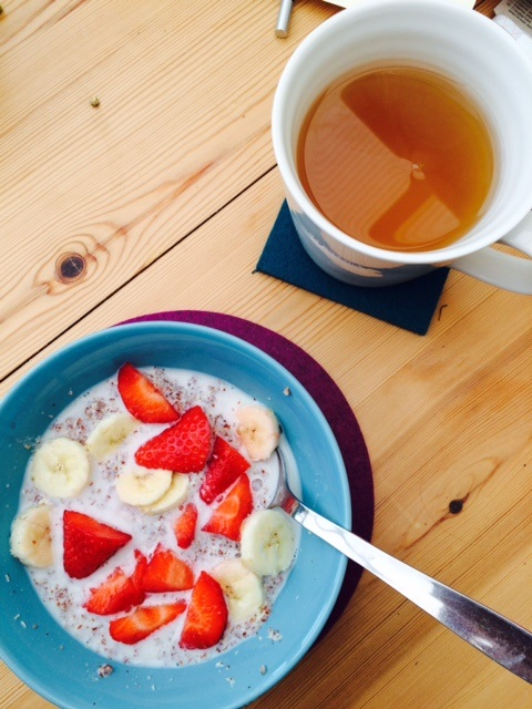 Quinoa Porridge wih Strawberries, banana and Ginger Tea